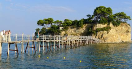 The port of Agios Sostis and the island of Cameo