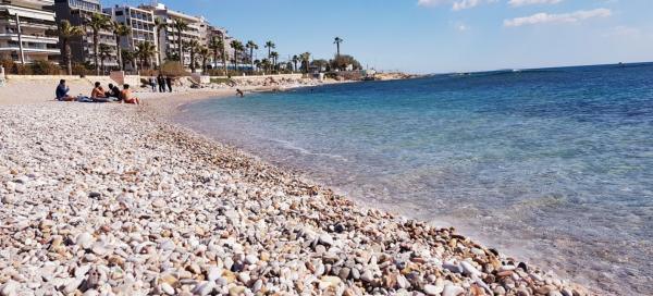Pebble beach at the port of Athens