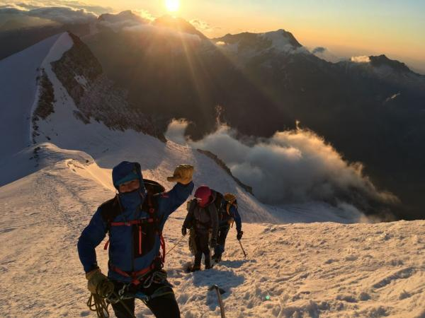 Ascent to Nadelhorn, the sun rising behind us